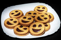 Happy food smiley biscuits in white plate Stock Photo