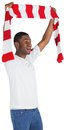 Happy football fan waving scarf on white background Royalty Free Stock Image