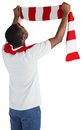 Happy football fan waving scarf on white background Stock Image