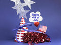 Happy fourth th of july party table decorations with hat streamers sign flag and stars in usa america red white and blue theme Royalty Free Stock Images