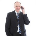 Happy friendly businessman on mobile Royalty Free Stock Image