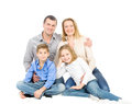 Happy friendly family young man woman boy and girl as a they are and smiling photo on the white background Stock Photo