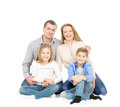 Happy friendly family young man woman boy and girl as a they are and smiling photo on the white background Stock Images