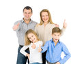 Happy friendly family young man woman boy and girl as a they are and smiling photo on the white background Stock Image