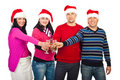 Happy friends celebrating Christmas Royalty Free Stock Image