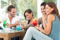Happy Friends Drinking Juices Royalty Free Stock Photos