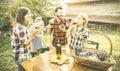 Happy friends having fun drinking wine at winery vineyard Royalty Free Stock Photo