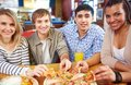 Happy friends image of teenage eating pizza in cafe Royalty Free Stock Photo