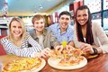Happy friends image of teenage eating pizza in cafe Stock Photography