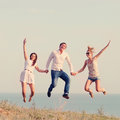 Happy friends jumping on the beach summer Royalty Free Stock Photo