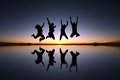 Happy friends jumping outdoor a group of young in solar de uyuni bolivia Stock Photography
