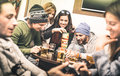 Happy friends playing table board game while drinking beer Royalty Free Stock Photo