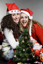 Happy friends with santa and christmas tree Stock Photography