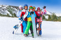Happy friends with snowboards and skis group of smiling men women standing on the mountains background Royalty Free Stock Image