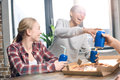 Happy friends spending time together with pizza and soda drinks Royalty Free Stock Photo