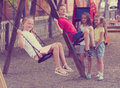 Happy friends swinging on swing Royalty Free Stock Photo