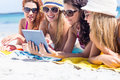 Happy friends wearing sun glasses and using tablet Royalty Free Stock Photo