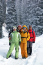 Happy friends in winter forest Stock Photo