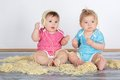 Happy fun messy eaters baby toddlers having eating pasta Stock Photo