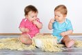 Happy fun messy eaters baby toddlers having eating pasta Stock Photos