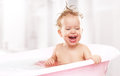 Happy funny  baby  laughing and bathed in bath Royalty Free Stock Photo