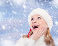 Happy funny girl in a Christmas hat Royalty Free Stock Photography