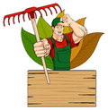 Happy gardener conceptual illustration of a smiling with rake below him there is a wooden sign with space for text isolated on Stock Photos