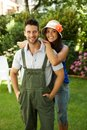 Happy gardening couple smiling outdoors young loving embracing looking at camera Royalty Free Stock Photos