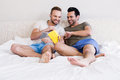 Happy gay couple reading book Royalty Free Stock Photo