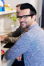 Happy gay couple working together in office Stock Photography