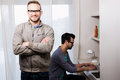 Happy gay couple working together in office Stock Image