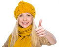 Happy girl in autumn clothes showing thumbs up Stock Photos