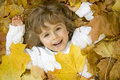 Happy girl in autumn leaves Royalty Free Stock Photos