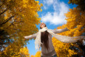 Happy girl on a autumn sky background Royalty Free Stock Photo