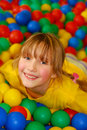 Happy girl in ball pool Royalty Free Stock Photo