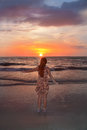 Happy girl on the beach at sunset beautiful sunrise young enjoying in clearwater florida Stock Photo
