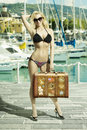 Happy girl with bikini and bag blonde ready to travel in summertime wearing sexy taking in left hand she smiling Stock Images