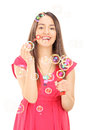 Happy girl blowing bubbles isolated on white background Royalty Free Stock Image