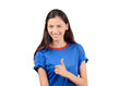 Happy girl with blue t shirt signing thumbs up woman smiling isolated on white Stock Photo