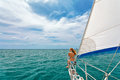 Happy girl on board of sailing yacht have a fun. Royalty Free Stock Photo