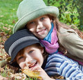 Happy girl and boy enjoying autumn season portrait of golden fall Stock Image