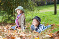 Happy girl and boy enjoying in a fall Stock Photography