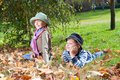 Happy girl and boy  enjoying golden autumn Royalty Free Stock Image
