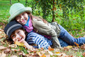 Happy girl and boy  enjoying golden autumn Royalty Free Stock Photography