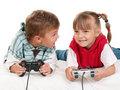 Happy girl and boy playing a video game Stock Image