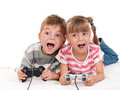 Happy girl and boy playing a video game Royalty Free Stock Photo