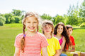 Happy girl with braids and her three friends in summer time Royalty Free Stock Image