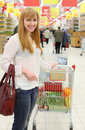 Happy girl and cart with food Stock Photography