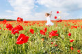 Happy girl with colorful balloons in poppies Royalty Free Stock Photo
