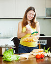 Happy girl cooking sandwiches with mayonnaise sauce in her kitchen Royalty Free Stock Photo